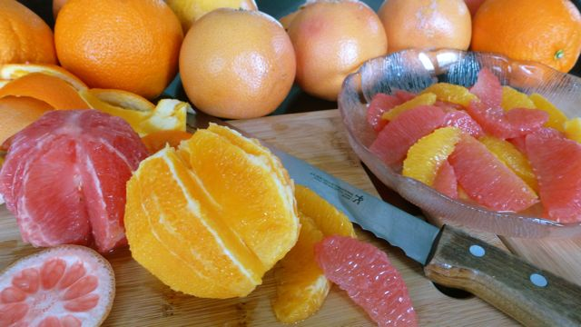 Fresh grapefruit and orange segments, citrus fruit is in season.