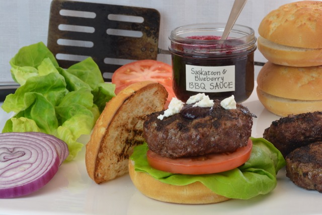 Bison Burgers with Saskatoon Blueberry Barbecue Sauce right off the grill