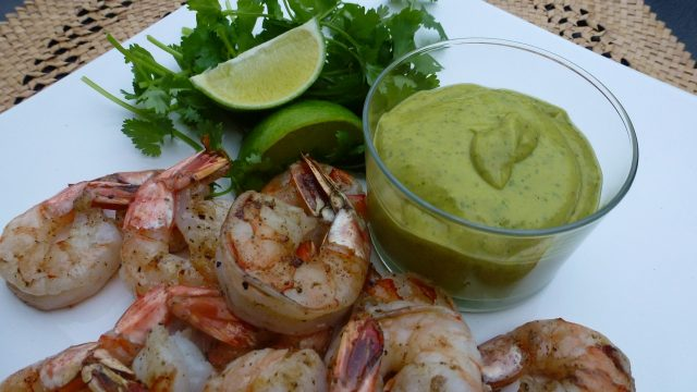 A dish of Gluten Free Avocado Chipotle Sauce with grilled shrimp.
