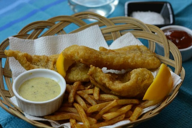 Gluten free Battered Fish and Chips served in a basket.