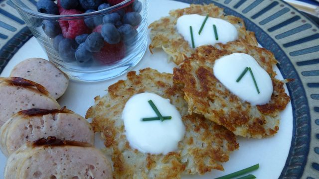 Gluten Free Potato Latkes topped with sour cream.