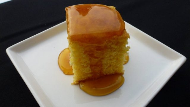 A plate of gluten free cornbread covered in corn syrup