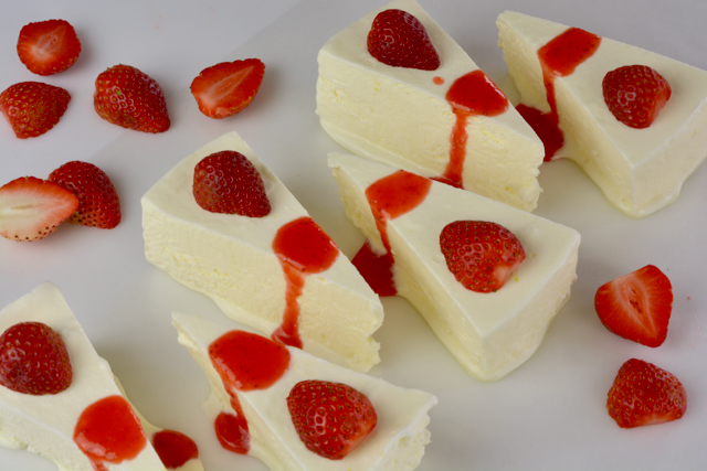 Wedges of Lemon Kulfi topped with strawberry sauce to end an East Indian menu.