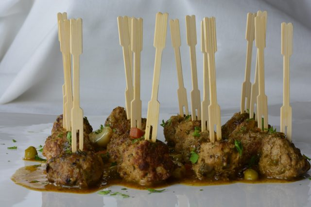 Meatballs in Almond Sauce served as an appetizer with toothpicks