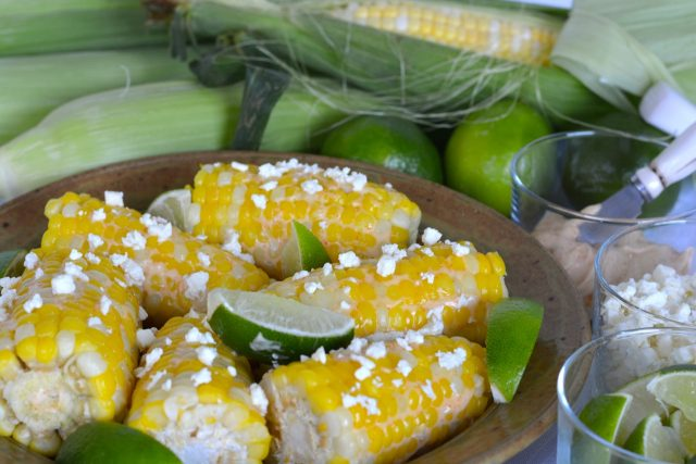 A serving dish of Corn with Feta and Lime ready to eat.